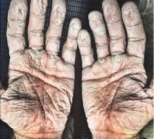 hands of an ocean paddler